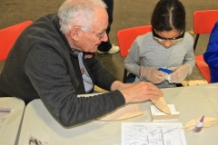 SOGGI member Ray Munro working with a young member building the balsa hand launch